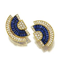 PAIR OF SAPPHIRE AND DIAMOND 'FAN' EARCLIPS The stylized semi-circular plaques set with two rows of calibré-cut sapphires and with 110 round diamonds weighing a total of approximately  6.50 carats, mounted in 18 karat gold.