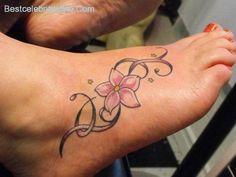 nice 13 Flirty Flower Foot Tattoos