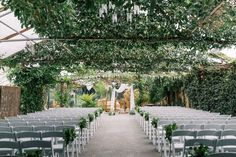 This jaw-dropping outdoor ceremony is dressed with amazing greenery from top to bottom creating a lush oasis experience 🥰🌿   Photo Credit: Elizabeth In Love | Venue: Madsen's Outdoor Ceremony, Wedding Ceremony, Banquet, Garden Inspiration, Photo Credit, Oasis, Lush, Greenery, Table Decorations