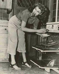 Rita Hayworth making toast