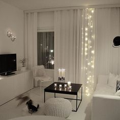 Living room | Eclectic + Minimal - String Lights behind Sheer Curtains with monochrome decor