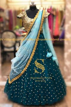 Beautiful bottle green color bridal lehenga and gold sequence blouse with ice blue color net dupatta. Lehenga with hand embroidery buti work allover. Indian Bridal Outfits, Indian Bridal Lehenga, Indian Designer Outfits, Indian Dresses, Half Saree Lehenga, Lehnga Dress, Lehenga Dupatta, Half Saree Designs, Lehenga Designs