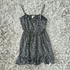 Black Floral Summer Dress F21 Summer dress. Cute button details on chest area. Perfect for summer. Worn once, I washed this and now it's too small for me. Size is M but would best fit a S. Forever 21 Dresses Mini