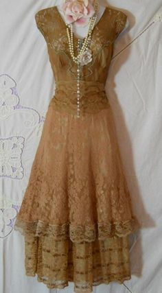 This vintage lace dress is filled with dreaminess.