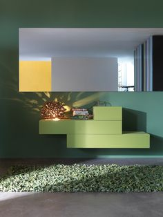 Commode verte design by Lago éléments 36e8 fermés en verre brillant. #Mettezduvertdansladéco #lago #vert #green #arlydesign #commodedesign #buffetdesign