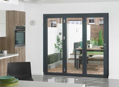 The Supreme 3 door, full aluminium bi-fold doors in grey are made from start to finish right here in the UK in our purpose built production facility to the same high quality as all Vufold doors. External Sliding Doors, Concertina Doors, Door Alternatives, Porch Doors, Interior Architecture, Interior Design, Aluminium Doors, Mid Century Modern Decor, Modern Exterior