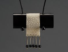 Imre Molnár leather works from Hungary - Stingray leather and ebony necklace