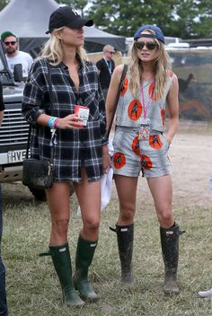 Cressida Bonas (Prince Harry's ex) battles the infamous Glastonbury mud and rain with wellington boots and a backwards hat.