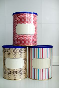 Empty formula tins - for flour and sugar and such.  Simply cover in scrapbook paper and contact. Use whiteboard marker to label.