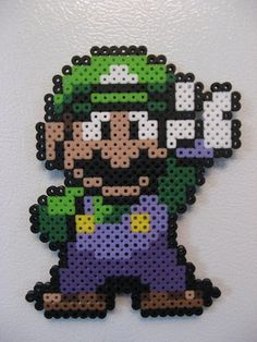 Luigi- with Perler beads - would be simple to convert to a cross stitch pattern