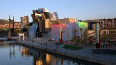 """A fusion of complex, swirling forms and captivating materiality, Gehry's Guggenheim Museum not only changed the way that architects and people think about museums, but also boosted Bilbao's economy. In fact, the phenomenon of a city's transformation following the construction of a significant piece of architecture is now referred to as the """"Bilbao Effect."""""""