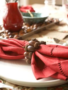 Acorn Napkin Ring - Better Homes and Gardens    Acorn Napkin Ring  Prev  22/28  Next  Acorn Napkin Ring    Acorns become table jewelry when wired together to make a napkin ring. Drill tiny holes through the sides of nine or 10 acorns. Alternate acorns top-to-bottom as you string them onto wire so they nestle together easily. Twist the wire ends together and slip the loop over a rolled napkin.