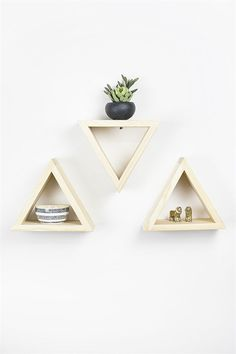 3 triangle wall shelves perfect for decorating any home or apartment. These three shelves are a unique design that gives any space an uplifting improvement. Hang with the natural pine or paint them any color you'd like to match your decor.