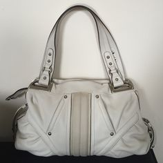 """B. Makowsky genuine leather off white shoulder bag Cream leather with silver hardware. 2 slip pockets on front, zip pockets on sides and small slip on back. Shoulder drop is 10"""".  Interior has leopard print lining with back wall zipper pocket and cell phone pockets b. makowsky Bags Shoulder Bags"""