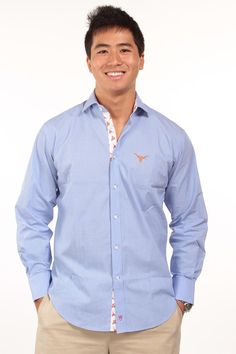Show your classic Texas style with the End on End dress shirt from Thomas Dean, in solid blue with a Burnt Orange Longhorn embroidered on the left chest.