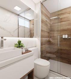 Banheiro social com direito a marmorizado e revestimento imitando a madeira. A composição perfeita! assinado por Studio 83 Arquitetura.…