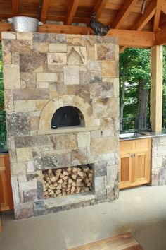 Outdoor Stone Pizza Oven with Wood Box and Attached Cabinets Outdoor Life, Outdoor Rooms, Outdoor Living, Outdoor Decor, Outdoor Kitchen Bars, Outdoor Oven, Outdoor Kitchens, Pizza Oven Fireplace, Bakers Oven