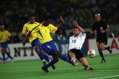 Brazil 2 Germany 0 in 2002 in Yokohama. Roque Junior clears as Bernd Schneider lunges in at the World Cup Final. 2002 World Cup, World Cup Final, Yokohama, Lunges, Finals, Brazil, Germany, Sports, Hs Sports