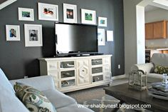 LOVE the t.v. stand and photos behind t.v. for family room wall