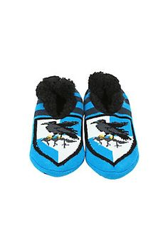 """Keep your feet warm while you wander the halls of Hogwarts and show off your house pride with these slippers from <i>Harry Potter</i> <span>. The blue and black striped knit slippers have ultra soft black fuzzy lining with a Ravenclaw crest on the toes and non-slip grip soles. So you won't slip when the stairs switch.</span><div><ul><li style=""""list-style-position: inside !important; list-style-type: disc !important"""">One size fits most</li><li style=""""list-style-position: inside !important…"""