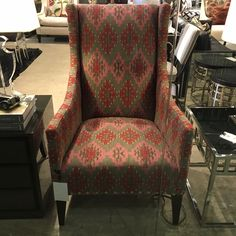 Shown is our Pluto Chair in Orillo Pink fabric. #andrewmartin #interiordesign #decor #fabric #textile #pink #red #pattern #livingroom #chair #lounge
