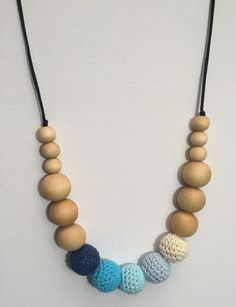 Mason and birdie Shop @ www.masonandbirdie.com Trendy silicone, crocheted, and wood teething jewelry and baby accessories. Our products are lovingly made and selected to keep you stylish and your little ones happy! Makayla - Crocheted and Wooden Teething Bead Necklace