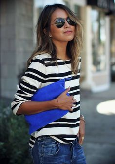 Shop this look for $88:  http://lookastic.com/women/looks/blue-clutch-and-black-sunglasses-and-white-and-black-longsleeve-shirt-and-navy-jeans/3904  — Blue Suede Clutch  — Black Sunglasses  — White and Black Horizontal Striped Longsleeve Shirt  — Navy Jeans