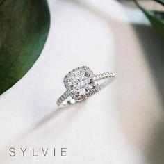 "A gorgeous halo engagement ring to ""cushion"" your fall into love... PC: Providence Diamond #SylvieCollection #SomethingSylvie #GetEngagedWithSylvie #EngagementRings #Diamonds #Jewelry #RingOfTheDay #Fashion"