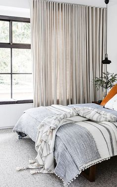 floor to ceiling curtains in modern bedroom with linen bedding / sfgirlbybay