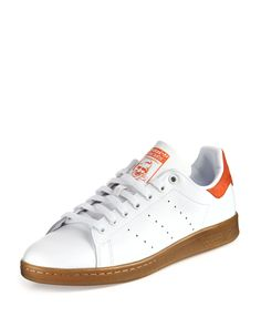 """Adidas """"Stan Smith"""" leather low-top sneaker. Round toe. Lace-up front. Stamped logo at tongue. Perforated sides in place of three-stripe. Padded collar. Raised logo at midsole. Gum rubber outsole. Imp"""