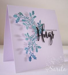 Handmade Christmas Holly Card Clean and Simple CAS idea in tones of blue, using Hugs die by Papertrey, Tim Holtz ink pads Evergreen Bough and Faded Jeans. Sue Wilson Holly die.