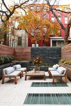 small & lovely outdoor space with recessed light panels by turett collaborative architects