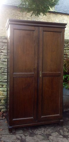 Antique Late 19th Century Victorian Oak Estate Hall Cupboard with Brass Hooks and Rail to interior, available from Hutchisonantiques.com