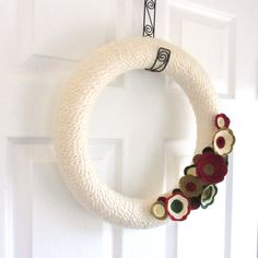 Christmas Yarn Wreath.  Holiday Felt Flower Wreath. Red, Green, Gold and Ivory. 14 Inch Door Wreath.. $55.00, via Etsy.