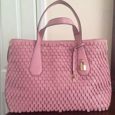 """Henri Bendel Leather Scalloped Dusty Rose XL Tote RARE Henri Bendel Extra Large Lock & (2) Keys Scalloped Leather Tote/Satchel/Shoulder Bag.  Pre-Owned Great Condition. Minor Flaws:  Small pen mark underside of 1 strap. Mark underneath other strap. See last pic. A couple of very small pen marks bottom interior. I disclose all! 9 out of 10 cond. Side zippers to open it up wider. Will fit laptops and most anything you want. Gorgeous gold sateen lining. Gold toned hardware. 19"""" W; 12"""" H. 5"""" W…"""