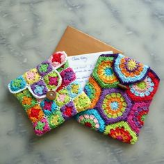 Mini granny square and hexagon pouches.