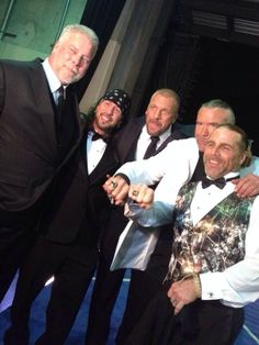 An epic moment for The Kliq as two of the five are WWE Hall of Famers. Scott Hall & Shawn Michaels flash their rings, along with Kevin Nash, Sean Waltman, & Triple H.