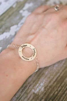 Name Bracelet - Hand Stamped Washer Bracelet - Sterling Silver - Circle Bracelet - Custom Names or Phrase - Personalized Bracelet. $43.00, via Etsy.