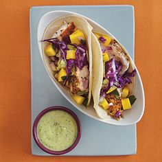 Fish Tacos with Lime Crema and Mango Salsa from #CookingLight #healthy #light #recipe