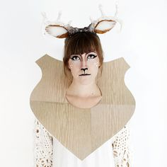 Bust out the makeup and a faux wooden plaque to make this taxidery costume.