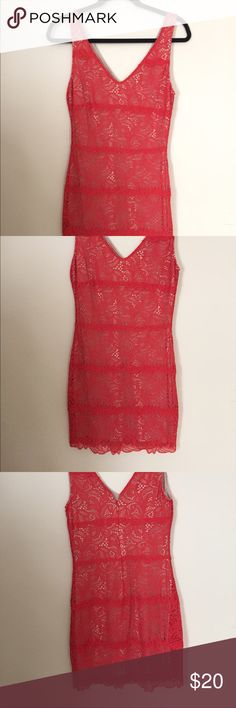 """Bebe Red Lace Bodycon Dress Bebe bodycon cocktail dress featuring a bright orange-red lace overlay over a nude lining. Deep V in both front and back. Size M, but fits like a S (I'd say roughly size 4). Hits ~2 inches above knee on 5'7"""". bebe Dresses Mini"""