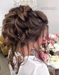 Featured Hairstyle: Elstile; Messy chic curly updo wedding hairstyle idea.