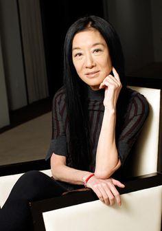 Vera Wang sitting a chair.