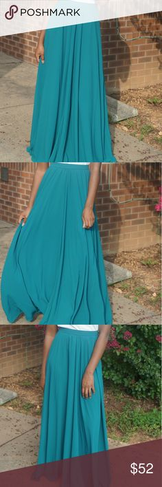 """Green Flowy Maxi Skirt This high-waisted skirthas a gorgeous flowy silhouette. The small pleats throughout create full volume and movement, making it the most playful skirt in your closet. It is super versatile, so you can dress it up with a nice blouse for a formal event or wear it with a tshirt for a cute casual outfit. No matter what it is sure to be a go-to item in your wardrobe.  Length 44 inches (Model is 5'6)  Fabric 100% Polyester  Size:  Small 