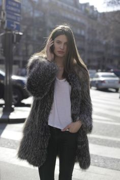 bianca balti in black pants, white shirt, and a fur coat - street style