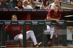 Paul Goldschmidt #44 and Brandon Drury #27 of the Arizona Diamondbacks watch from the dugout during the MLB game against the San Diego Padres at Chase Field on May 29, 2016 in Phoenix, Arizona.