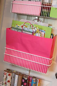 I love this gift wrap organizing rack behind the door. Yes!!. Finally something that works at your fingertips. Gift Bag Organization, Gift Bag Storage, Craft Storage, Organization Hacks, Storage Ideas, Storage Room, Storage Solutions, Organizing Solutions, Nursery Organization