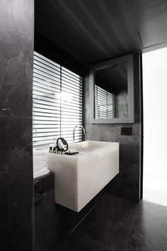 modernized alabaster becomes the vanity and sink in this bath at hotel habita mty.