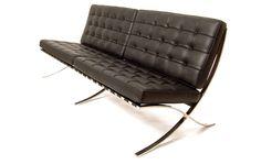 Mies van der Rohe Barcelona Sofa in dark brown or black leather.