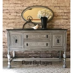 This vintage buffet was transformed using layers of gray and silver paints.